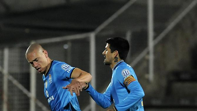 FC Porto's Maicon Roque, left, from Brazil celebrates with Lucho Gonzalez, from Argentina, after scoring the opening goal against Rio Ave in a Portuguese League soccer match, in Vila do Conde, northern Portugal, Sunday, Dec. 15, 2013. Maicon scored once in Porto's 3-1 victory