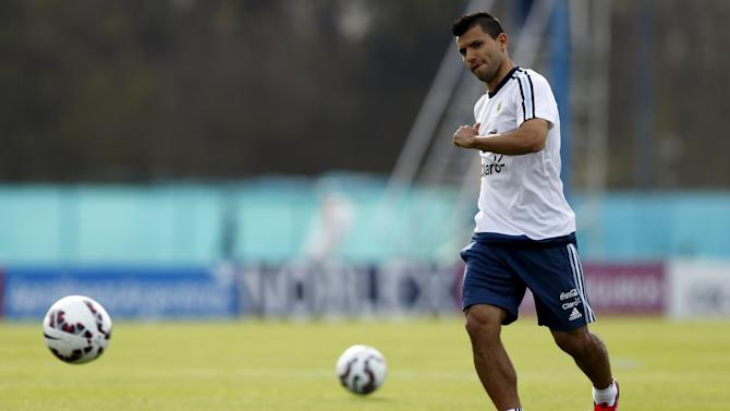 Argentina's Aguero kicks the ball during a training session in Buenos Aires