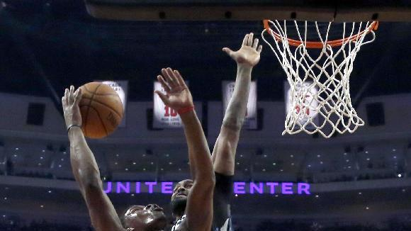 Minnesota Timberwolves center Ronny Turiaf, right, comes from behind and blocks the shot of Chicago Bulls guard Jimmy Butler during the first half of an NBA basketball game, Monday, Jan. 27, 2014, in Chicago