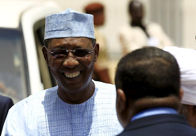 Chadian President Deby smiles as he arrives to attend Sudan's President Omar Hassan al-Bashir inauguration ceremony at the National Assembly in Omdurman
