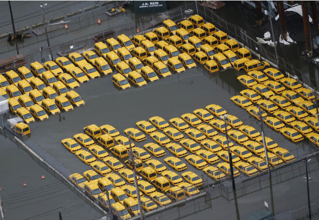 Taxis are submerged in floodwaters in the wake of superstorm Sandy