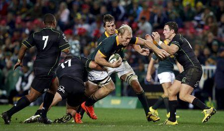 South Africa's Schalk Burger attempts to get past World XV players during their rugby union match  in Cape Town