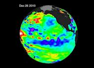 In this enhanced NASA satellite illustration from December 26, 2010, the La Niña is evident by the large pool of cooler than normal (blue and purple) water stretching from the eastern to the central Pacific Ocean. Despite the natural cooling trend brought by back-to-back La Nina effects, 2011 was among the 12 highest years on record for global sea surface temperatures