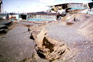 In this March 1964 photo released by the U.S. Geological Survey, the Government Hill Elementary School is shown destroyed by a landslide following an earthquake in Anchorage, Alaska. North America's largest earthquake rattled Alaska 50 years ago, killing 15 people and creating a tsunami that killed 124 more from Alaska to California. The magnitude 9.2 quake hit at 5:30 p.m. on Good Friday, turning soil beneath parts of Anchorage into jelly and collapsing buildings that were not engineered to withstand the force of colliding continental plates. (AP Photo/U.S. Geological Survey)