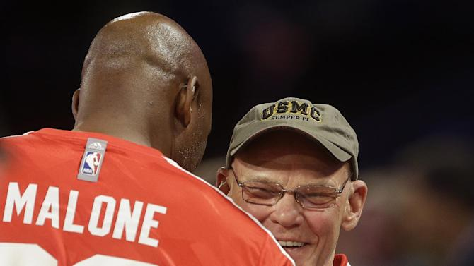 Political commentator and media personality James Carville, right, embraces former NBA player Karl Malone before the skills competition at the NBA All Star basketball Saturday Night, Saturday, Feb. 15, 2014, in New Orleans