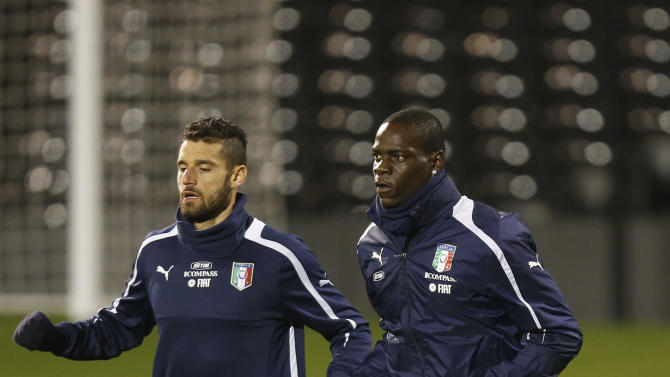 Italy's Mario Balotelli, right, and Antonio Candreva run during a training session at Craven Cottage in London, Sunday, Nov. 17, 2013. Italy is to play a friendly soccer match against Negeria on Monday Nov. 18 at Craven Cottage in London