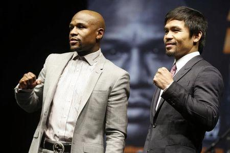"Eleven-time, five-division world boxing champion Floyd ""Money"" Mayweather and eight-division world champion Manny ""Pac-Man"" Pacquiao pose at a news conference ahead of their upcomi"