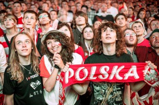 File picture. Polish football fans watch from the Warsaw fanzone on June 12, 2012 the Euro 2012 championships football match Poland vs Russia held at the National Stadium in Warsaw. Just five months after the final whistle at the European championships, economists and officials say that Poland is reaping the benefits.