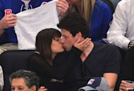 Lea Michele and Cory Monteith share a kiss at the New York Rangers vs New Jersey Devils playoff game at Madison Square Garden in New York City on May 16, 2012 -- Getty Premium