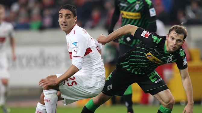 Stuttgart's Mohammed Abdellaoue, left, and Moenchengladbach's Tony Jantschke challenge for the ball during the German first division Bundesliga soccer match between VfB Stuttgart and Borussia Moenchengladbach Stuttgart, Germany, Friday, Nov. 22, 2013