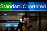 A branch of Standard Chartered bank in Hong Kong on August 1, 2012. New York's Department of Financial Services has threatened the bank with fines and possible suspension of its license to operate in the state, hub of the US financial industry, in the latest US move against foreign banks trading with Tehran