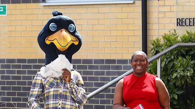 Jermain Defoe (wearing the cockerel mascot head) with his mother Tottenham Hotspur players and management at the Spurs training ground and village in Essex Essex, England - 30.04.12 Mandatory Credit: WENN.com