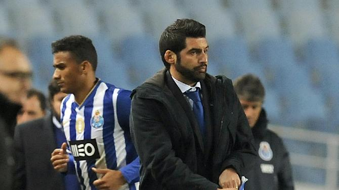 FC Porto's coach Paulo Fonseca, right, reacts after his team's 1-0 defeat against Academica in a Portuguese League soccer match at the Municipal Stadium in Coimbra, Portugal, Saturday, Nov. 30, 2013. Danilo Silva, from Brazil, at left, failed to score a penalty shot in the last minutes of the match