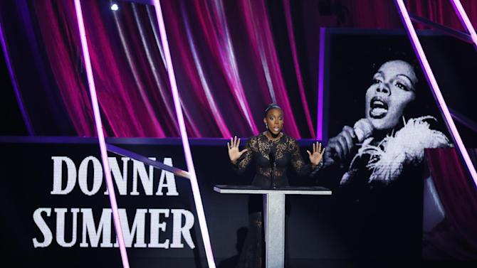 Kelly Rowland speaks while inducting Donna Summer posthumously into the Rock and Roll Hall of Fame during the Rock and Roll Hall of Fame Induction Ceremony at the Nokia Theatre on Thursday, April 18, 2013 in Los Angeles. (Photo by Danny Moloshok/Invision/AP)