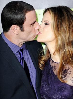 John Travolta, Kelly Preston Kiss on Red Carpet Amidst Masseur Scandal