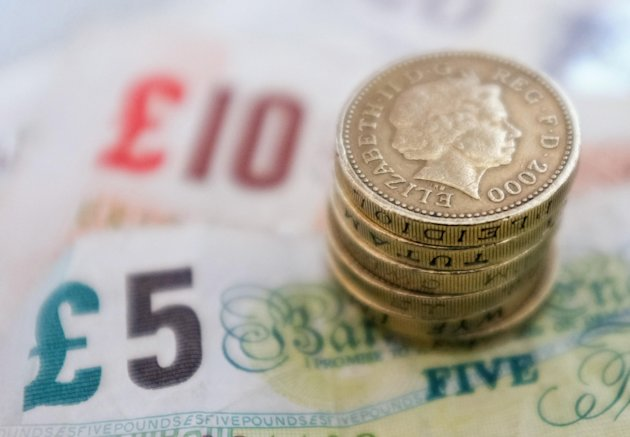 Filed photo dated 18/09/12 of money as workers on an average wage will be £29 a week worse off under reforms to the state pension, according to a new study.