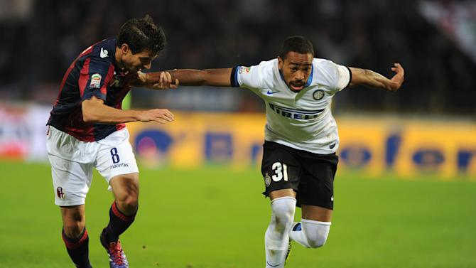 Bologna's Gyorgy Garics, left, challenges for the ball with Inter's lvaro Pereira during the Italian Serie A soccer match between Bologna and Inter Milan at the Renato Dall' Ara stadium in Bologna, Italy, Sunday, Nov. 24, 2013