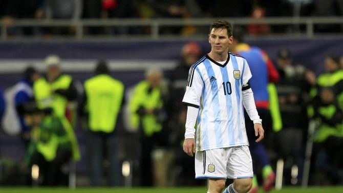 Argentina's Messi leaves the field at half time during their international friendly soccer match against Romania at the National Arena in Bucharest