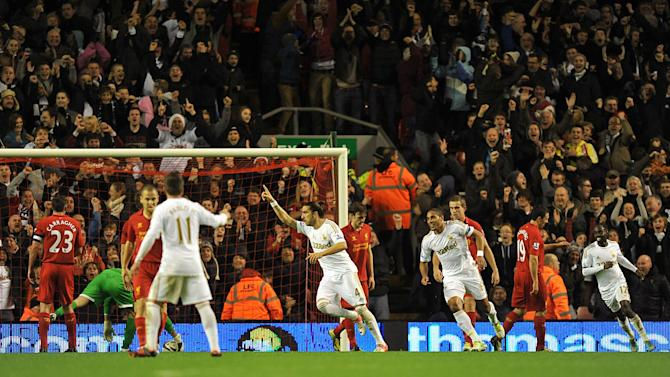 Chico, centre, scored Swansea's opener as they knocked Liverpool out of the Capital One Cup