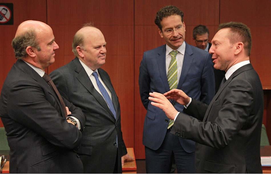 Greek Finance Minister Yannis Stournaras, right, talks with Spanish Economy Minister Luis de Guindos Jurado, left, Irish Finance Minister Michael Noonan, second left, and Dutch Finance Minister and Ch