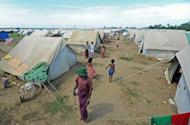 Muslim Rohingya people walk around the Bawdupha Internally Displaced Persons (IDP) camp on the outskirts of Sittwe on November 2. The UN's refugee agency has begun airlifting tents to provide shelter for thousands of people displaced by sectarian unrest in Myanmar's western Rakhine State