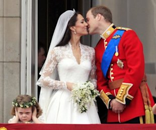 Who is that little girl frowning during the big kiss? Read on. (AP Photo)