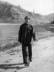 "Mao Zedong shown in a file photo dated 1942, walking in Yenan. The film ""Back to 1942"" tells of a largely forgotten disaster that left three million dead, seven years before Mao's Communists took over and almost two decades before his Great Leap Forward led to the deaths of tens of millions"