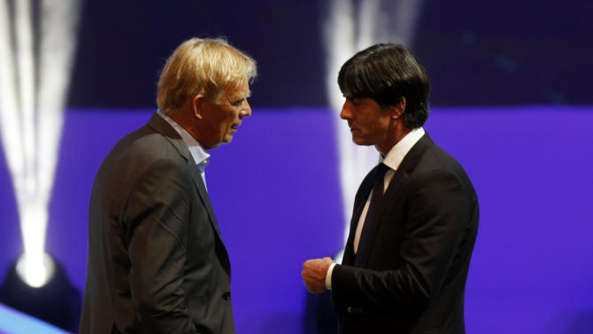 Germany's coach Joachim Loew speaks with Cameroon's coach Volker Finke after the draw for the 2014 World Cup finals was made at the Costa do Sauipe resort in Sao Joao da Mata