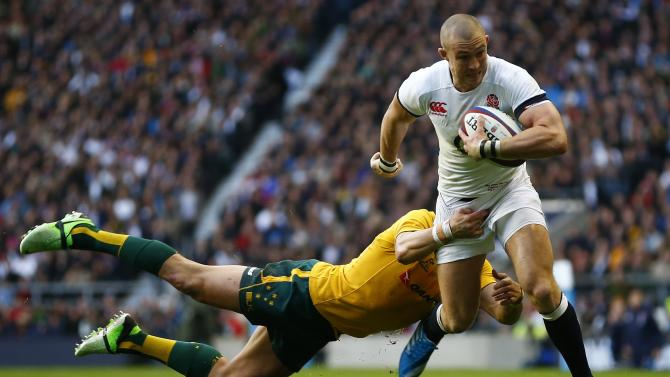 Australia's Ashley-Cooper tackles England's Brown during their international rugby union match in London