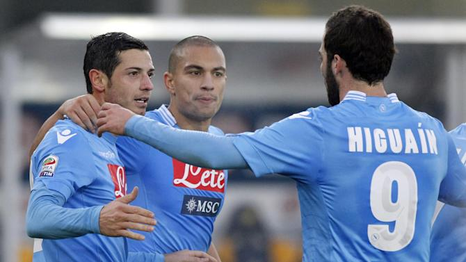 Napoli's Blerim Dzemaili, left, of Switzerland celebrates with teammate Gokhan Inler, center, and Gonzalo Higuain, of Argentina, after scoring during a Serie A soccer match against Hellas Verona at the Bentegodi stadium in Verona, Italy, Sunday, Jan. 12, 2014