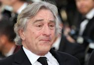 "A visibly moved Robert De Niro, pictured here, and his co-stars from ""Once Upon a Time in America"" Friday hosted a screening of the restored 1984 classic by Sergio Leone before a Cannes red-carpet crowd. The US actor had tears in his eyes as he climbed the steps of the festival palace to the sound of Ennio Morricone's original score"