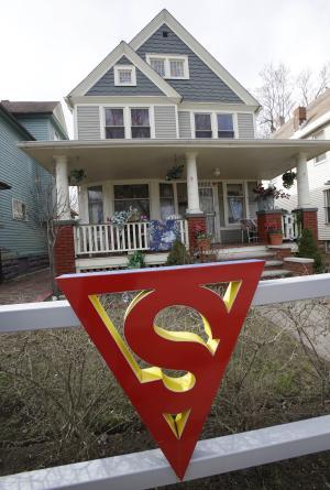 "In this Tuesday, April 2, 2013 photo shows the red ""S"" on a fence outside the home of Jerry Siegel in Cleveland. Superman collaborators Siegel and Joe Shuster lived several blocks apart in the Glenville neighborhood which shaped their lives, dreams for the future and their imagery of the Man of Steel. (AP Photo/Tony Dejak)"