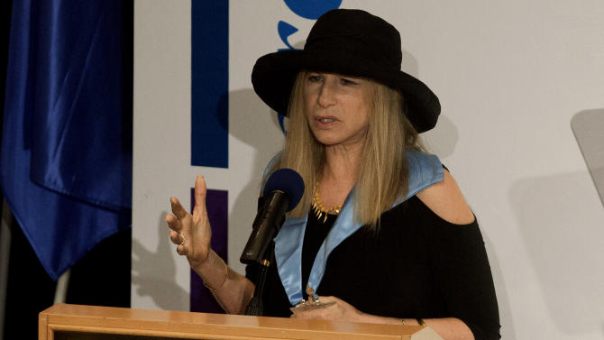 Entertainment star Barbra Streisand speaks during a ceremony at the Hebrew University in Jerusalem after she received an honorary doctorate in Jerusalem, Monday, June 17, 2013. Streisand waded into one of Israel's touchiest issues Monday on the first major stop of her tour of the country Jewish religious practices that separate men and women. (AP Photo/Dan Balilty)