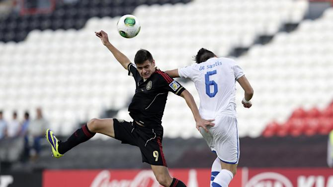 Italy's Ivan De Santis, right, and Mexico's Alejandro Diaz fight for the ball during the World Cup U-17 round of 16 soccer match between Italy and Mexico at Zayed sport city in Abu Dhabi, United Arab Emirates, Monday, Oct. 28, 2013