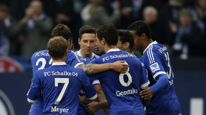 Schalke 04's players celebrate a goal against Eintracht Braunschweig during their German first division Bundesliga soccer match in Gelsenkirchen