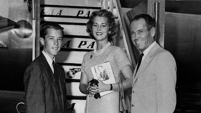 "FILE - In this June 25, 1957 file photo, movie actor Henry Fonda, right, with his children, Jane and Peter, are shown at New York International Airport boarding a clipper airplane for Europe where they'll spend the summer seeing sights.   On on Saturday, April 27, 2013, Jane Fonda, the 75-year-old Oscar winner , will place her hand and footprints next to her father's in the concrete shrine to celebrity outside Hollywood's TCL Chinese Theatre. Then she'll present a special screening of the film she made with her dad, ""On Golden Pond."" The cement and cinematic tribute is part of the 2013 TCM Classic Film Festival, which is honoring Jane Fonda.(AP Photo, File)"