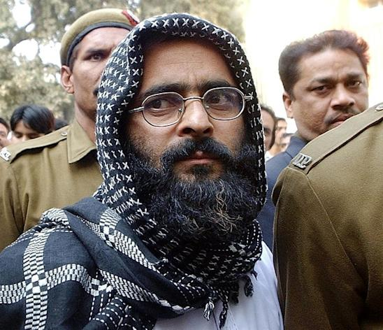 Indian police escort Mohammed Afzal Guru to the courthouse in New Delhi, on December 16, 2002. Guru -- sentenced to death for taking part in the plot to attack India's parliament in 2001 -- was executed after his final mercy plea was rejected by President Pranab Mukherjee