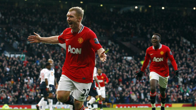 Manchester United's Paul Scholes celebrates scoring against Bolton Wanderers as teammate Danny Welbeck, right, looks on during their English Premier League soccer match at Old Trafford, Manchester, England, Saturday Jan. 14, 2012. (AP Photo/Tim Hales)