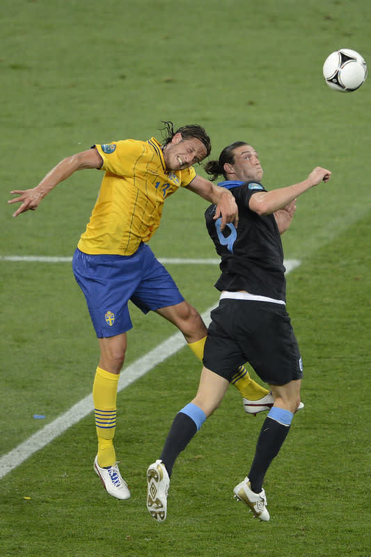 English Forward Andy Carroll (R) Vies AFP/Getty Images