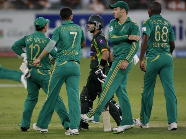 South African players celebrate the wicket of Pakistan's Ahmed Shehzad during their second Twenty20 international cricket match in Dubai