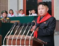 """This photo released by North Korea's official Korean Central News Agency (KCNA) on June 7 shows North Korean leader Kim Jong-Un (C) making a speech on June 6. South Korea accused North Korea of """"crossing the line"""" with its recent threats and insults, and pressed the impoverished country to start repayments for past food aid"""