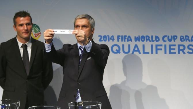 Savic head of FIFA World Cup Qualifiers displays name of Croatia during draw for 2014 World Cup European qualifying playoffs in Zurich