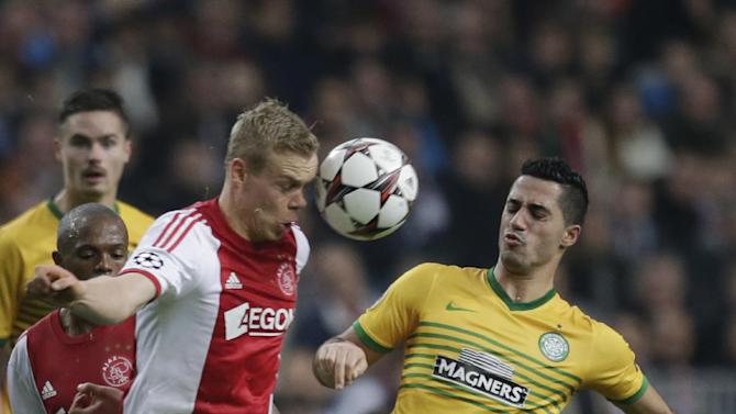 Ajax's Nicolai Boilesen, left, and Celtic's Emilio Izaguirre, right, vie for the ball during the Champions League Group H soccer match between Ajax Amsterdam and Celtic Glasgow at ArenA stadium in Amsterdam, Netherlands, Wednesday, Nov. 6, 2013