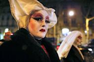 """Members of """"Les Soeurs de la Perpetuelle Indulgence"""" (Sisters of Perpetual Indulgence) walk in the streets near the French National Assembly in Paris on January 29, 2013. France's prime minister on Tuesday predicted that gay marriage will quickly be accepted by a country that has spent months embroiled in rancorous debate"""