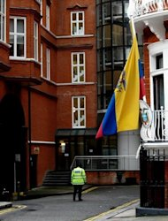 A British police officer patrols in June 2012 outside the Ecuadorian embassy in London. Even if Ecuador decides to grant Wikileaks founder Julia Assange political asylum, it remains to be seen if British authorities would allow him to leave the country. In the absence of a safe conduct agreement between Quito and London, he could stay on embassy grounds indefinitely