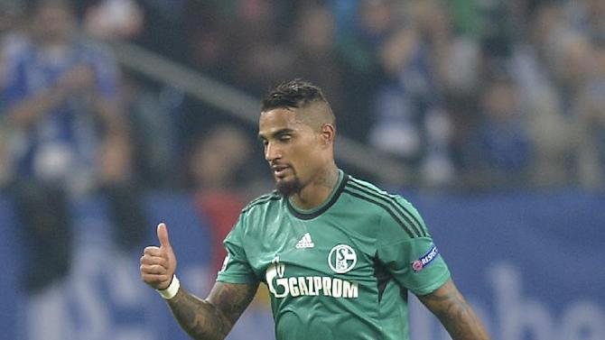 Schalke's Kevin-Prince Boateng, right, celebrates after scoring his team's second goal during the Champions League Group E soccer match between FC Schalke 04 and Steaua Bucharest  in Gelsenkirchen, Germany, Wednesday, Sept. 18, 2013