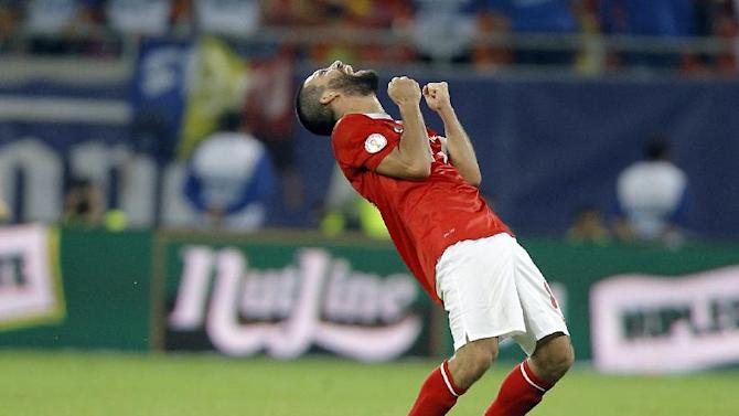 Turkey's Arda Turan celebrates at the end of a World Cup Group D qualifying soccer match between Romania and Turkey at the National Arena stadium in Bucharest, Romania, Tuesday, Sept. 10, 2013. Turkey defeated Romania 2-0