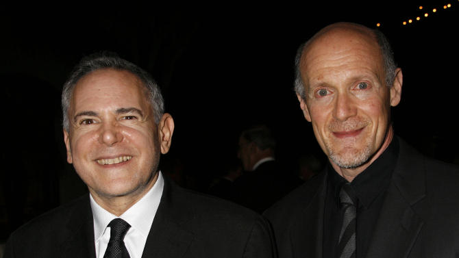 """FILE - This Nov. 15, 2007 file photo shows Craig Zadan, left, and Neil Meron, producers of the film """"Hairspray"""" at the Santa Barbara International Film Festival's Kirk Douglas Award for Excellence in Film presented to actor John Travolta in Santa Barbara, Calif.   Zadan and Meron will produce the Oscars again. The film academy announced Tuesday, April 17, 2013, that it has invited Zadan and Meron to return for the 2014 Academy Awards telecast. (AP Photo/Michael A. Mariant, file)"""