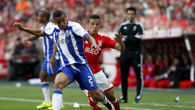 Benfica's Rodrigo Lima fights for the ball with Porto's Danilo Silva during their Portuguese Premier League soccer match at Luz stadium in Lisbon