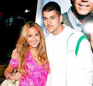 "Adrienne Bailon ""Excited"" to Have Rob Kardashian Tattoo Removed"